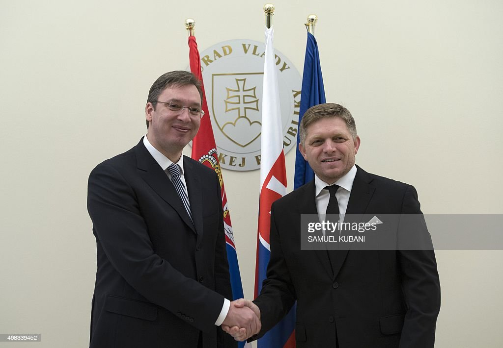 Serbia's Prime Minister Aleksandar Vucic (L) and Slovakian Prime Minister <a gi-track='captionPersonalityLinkClicked' href=/galleries/search?phrase=Robert+Fico&family=editorial&specificpeople=555594 ng-click='$event.stopPropagation()'>Robert Fico</a> shake hands during a meeting in Bratislava, Slovakia, on April 2, 2015. Serbia's Prime Minister Vucic arrived for a one-day offical visit in Slovakia. AFP PHOTO / SAMUEL KUBANI