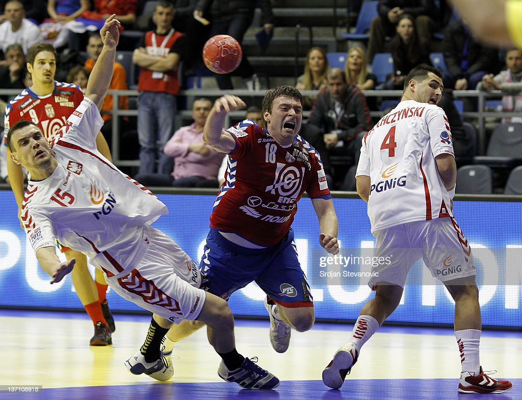 Serbia's Rastko Stojkovic in action against Poland Patryk Kuchczynski (R) and Mihal Jurecki during the Men's European Handball Championship group A match between Poland and Serbia at Pionir Sports Centre on January 15, 2011 in Belgrade, Serbia.