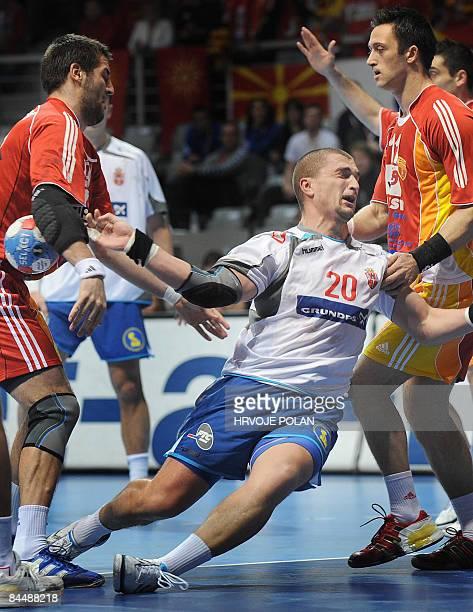 Serbia's Ratko Nikolic tries to score in front of Macedonia's Vladimir Temelkov during their World Handball Championship match in Zadar on January 27...