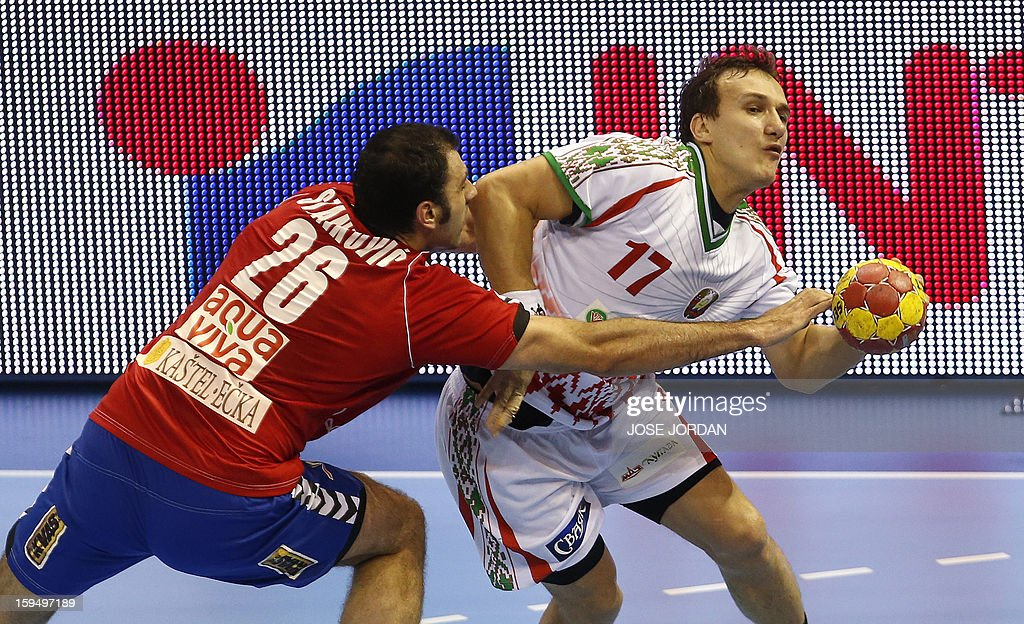 Serbia's right back Ivan Stankovic (L) vies with Belarus' centre back Dzmitry Nikulenkau during the 23rd Men's Handball World Championships preliminary round Group C match Belarus vs Serbia at the Pabellon Principe Felipe in Zaragoza on January 14, 2013.