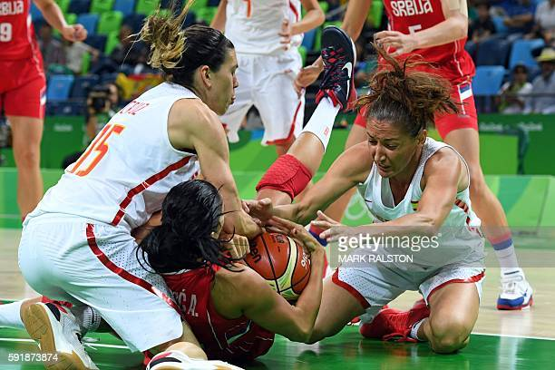 Serbia's shooting guard Ana Dabovic holds on to the ball between Spain's guard Anna Cruz 9L and Spain's point guard Laia Palau during a Women's...