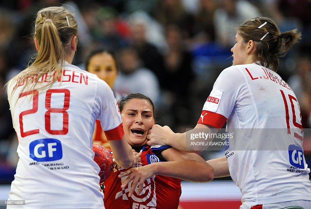 Serbia's Sladjana Pop-Lazic (C) vies with Denmark's Stine Jorgensen (L) and Line Jorgensen during their Women's EHF Euro 2012 Handball Championship match Serbia vs Denmark on December 11, 2012, at the Belgrade Arena.