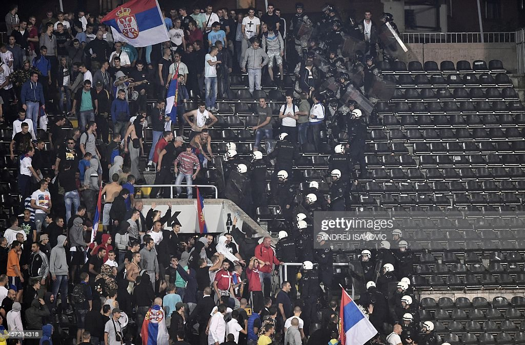 Serbia's supporters riot police scuffles with angry Serbian supporters during the EURO 2016 group I football match between Serbia and Albania in...