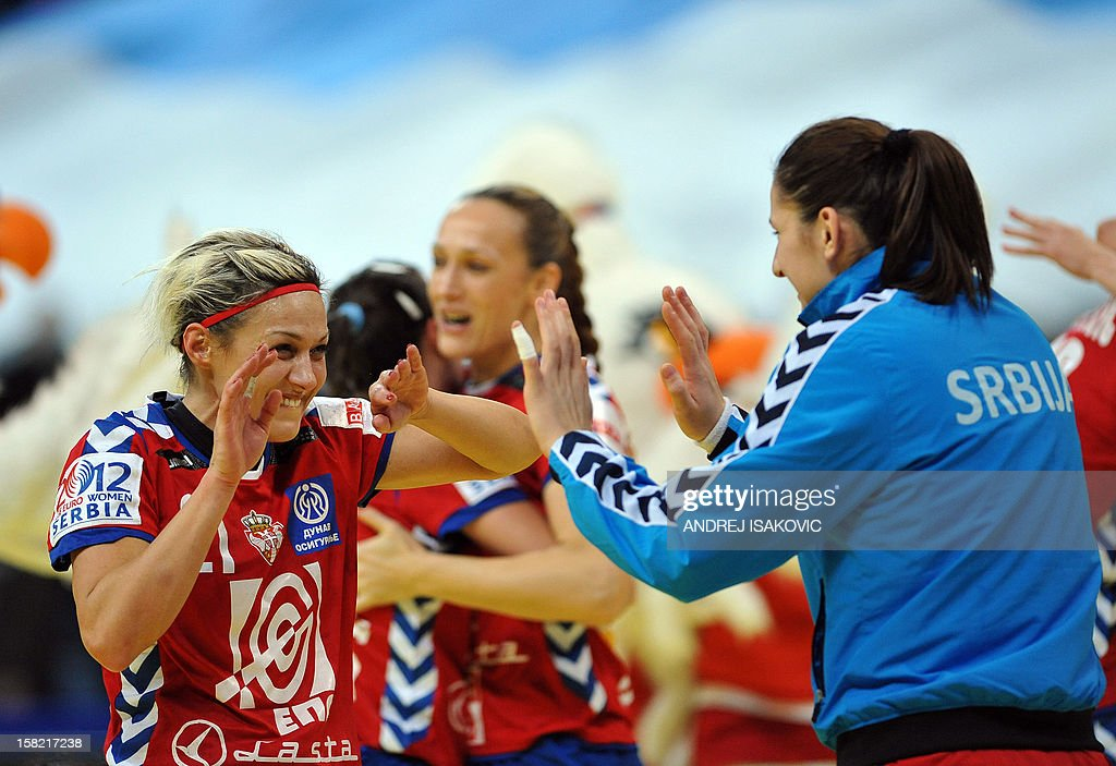Serbia's Svetlana Ognjenovic (L) and one of her team mates celebrate their victory during their Women's EHF Euro 2012 Handball Championship match Serbia vs Denmark on December 11, 2012, at the Belgrade Arena.