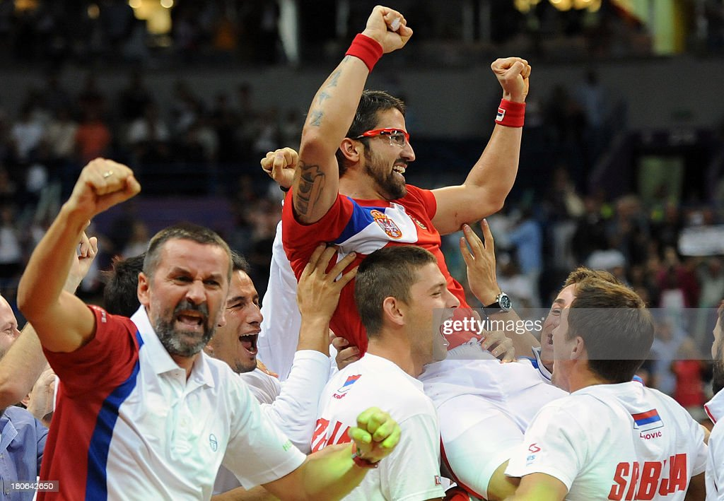 Serbia's team celebrates after Sebia's Janko Tipsarevic defeated Canada's Vasek Pospisil in the Davis Cup semi-final match between Serbia and Canada at the Belgrade Arena on September 15, 2013. Serbia, the 2010 champions, will host the November 15-17 final against the Czechs who defeated Argentina 3-2 in their semi-final in Prague.