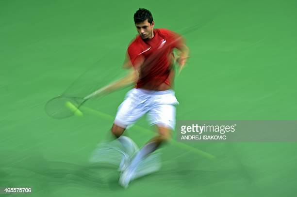 Serbia's tennis player Filip Krajinovic returns the ball to Croatia's tennis player Franko Skugor during their Davis Cup World Group first round one...