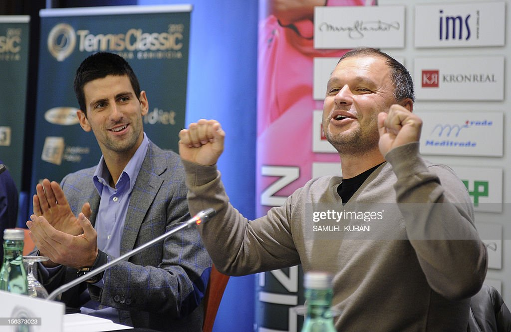 Serbia's tennis player Novak Djokovic (L) applauds to his coach Marian Vajda during a press conference on November 14, 2012 in Bratislava. Djokovic with his coach Marian Vajda will play against Slovak players Martin Klizan and Dominik Hrbaty at Tennis Classic exhibition match in Bratislava. AFP PHOTO/SAMUEL KUBANI