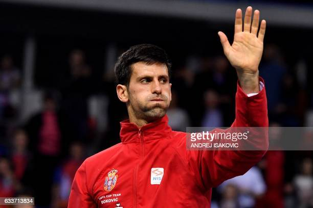 Serbia's tennis player Novak Djokovic reacts after winning against Russia's tennis player Daniil Medvedev during the Davis Cup World Group first...