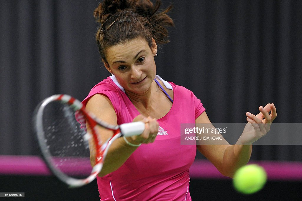 Serbia's tennis player Vesna Dolonc returns the ball to Slovakia's Daniela Hantuchova during the Fed cup World group first round tie tennis match between Serbia and Slovakia on February 10, 2013, in Nis.