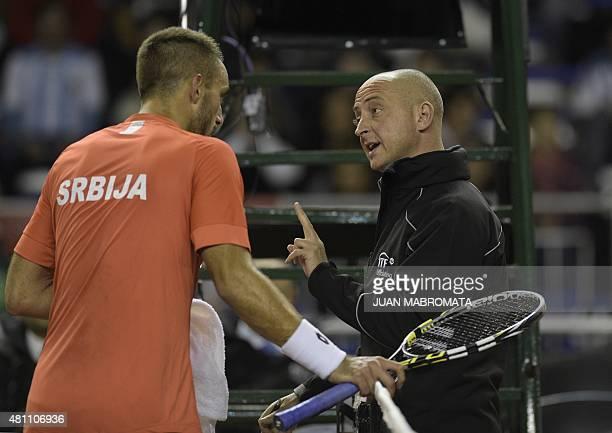 Serbia's tennis player Viktor Troicki and chair umpire Pascal Maria speak during the Davis Cup World Group quarterfinal single tennis match against...