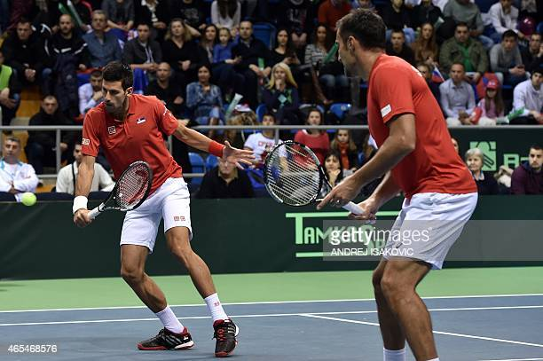 Serbia's tennis players Novak Djokovic and Nenad Zimonjic compete against Croatia's tennis players Marin Draganja and Franko Skugor during their...