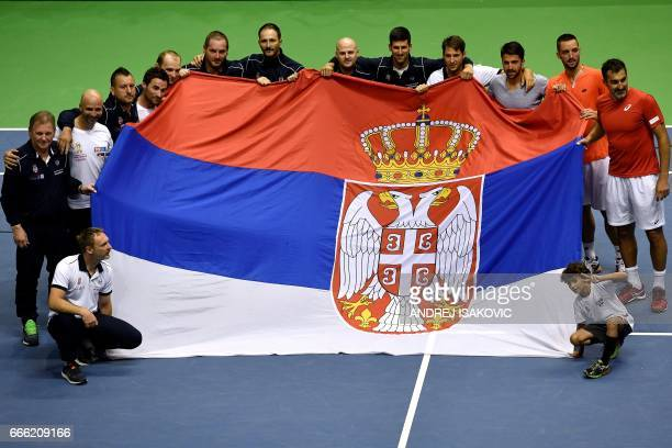 Serbia's tennis team celebrate their victory after the Davis Cup World Group quarterfinal between Serbia and Spain at the Aleksandar Nikolic Sports...