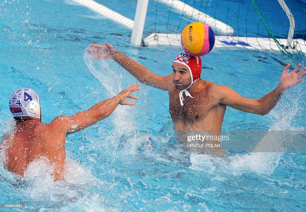 Serbia's Vanja Udovicic tries to score against Croatia's goalkeeper Josip Pavic during their European Waterpolo Championships semifinal match in...