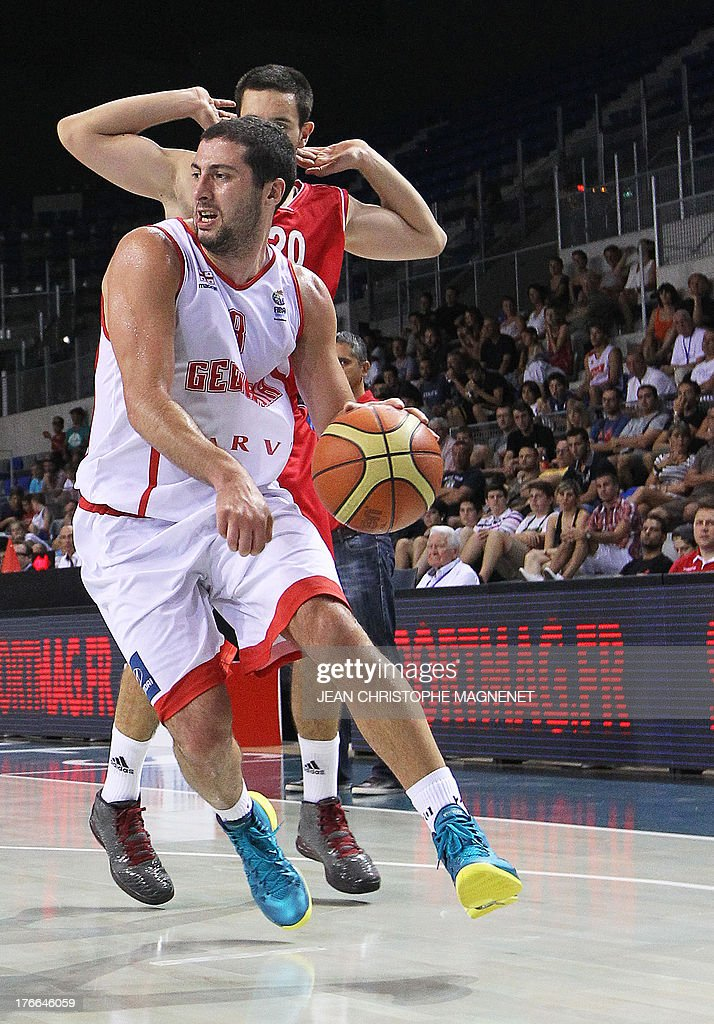 Serbia's Vasijile Micic (back) vies with Georgia's George Tsintsadze (front) during a friendly basketball match between Serbia and Georgia on August 16, 2013 in Antibes, southeastern France as part of the preparation for the 2013 EuroBasket in Slovenia.