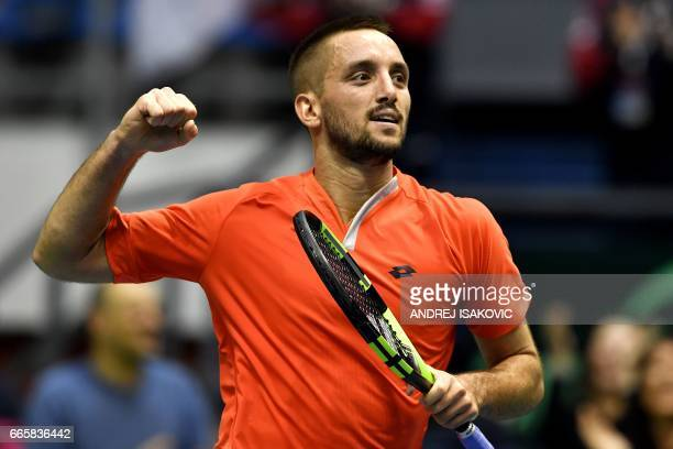 Serbia's Viktor Troicki celebrates after winning against Spain's Pablo Carreno Busta the Davis Cup World Group quarterfinals second single match...