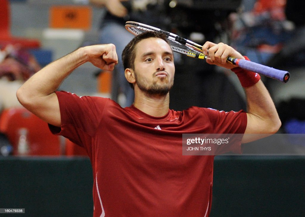 Serbia's Viktor Troicki celebrates after winning (6/1,6/3,6/7,4/6,4/6) during his Davis Cup first round tennis match against Belgium's David Goffin on February 1, 2013 in Charleroi.