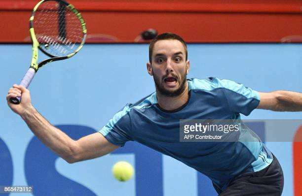 Serbia's Viktor Troicki plays against Germany's Alexander Zverev in their first round match of men's singles during the ATP tournament in Vienna...