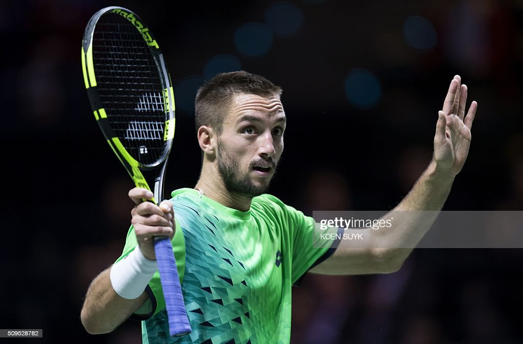 Serbia's Viktor Troicki reacts after winning over South Korea's Hyeon Chung during their second round match of the ABN AMRO World Tennis Tournament in Rotterdam, Netherlands, on February 11, 2016. / AFP / ANP / Koen Suyk / Netherlands OUT