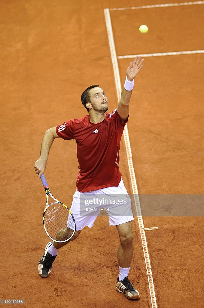 Serbia's Viktor Troicki serves a ball to returns Belgium's David Goffin during their Davis Cup first round tennis match on February 1, 2013 in Charleroi.