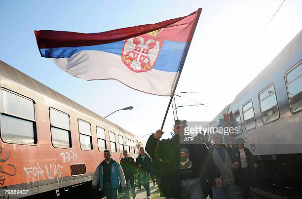 Serbs wave a Serbian flag as they arrive at Belgrade railway station for an antiKosovo independence rally on February 21 2008 A day after NATOled...