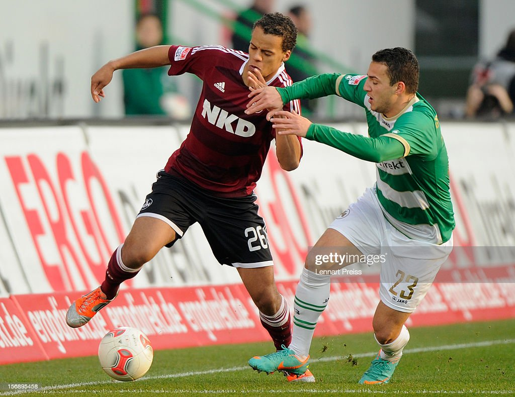 Sercan Sararer (R) of Fuerth challenges Timothy Chandlerof Nuernberg during the Bundesliga match between SpVgg Greuther Fuerth and 1. FC Nuernberg at Trolli-Arena on November 24, 2012 in Fuerth, Germany.