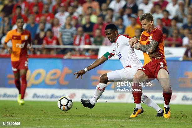 Serdar Aziz of Galatasaray in action against Samuel Etoo of Antalyaspor during the 4th week of the Turkish Super Lig match between Antalyaspor and...