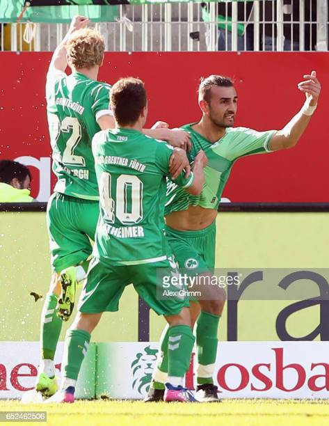 Serdar Dursun of Greuther Fuerth celebrates his team's first goal with team mates during the Second Bundesliga match between SV Sandhausen and SpVgg...