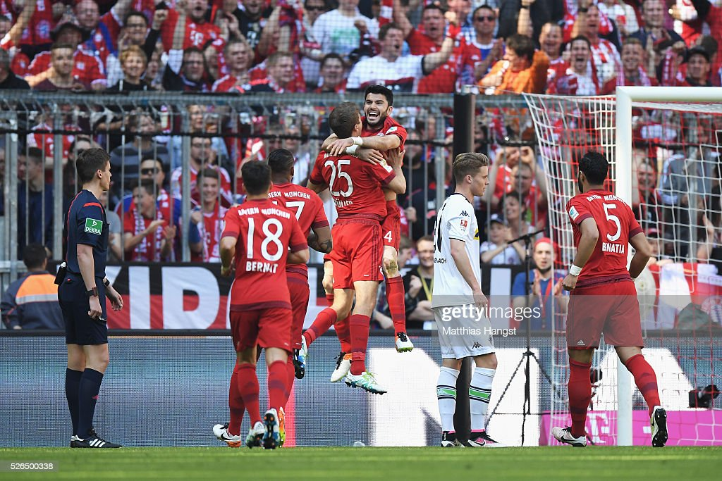Serdar Tasci (3rd R) of Bayern Muenchen celebrates scoring his team's first goal with his team mates during the Bundesliga match between Bayern Muenchen and Borussia Moenchengladbach at Allianz Arena on April 30, 2016 in Munich, Germany.