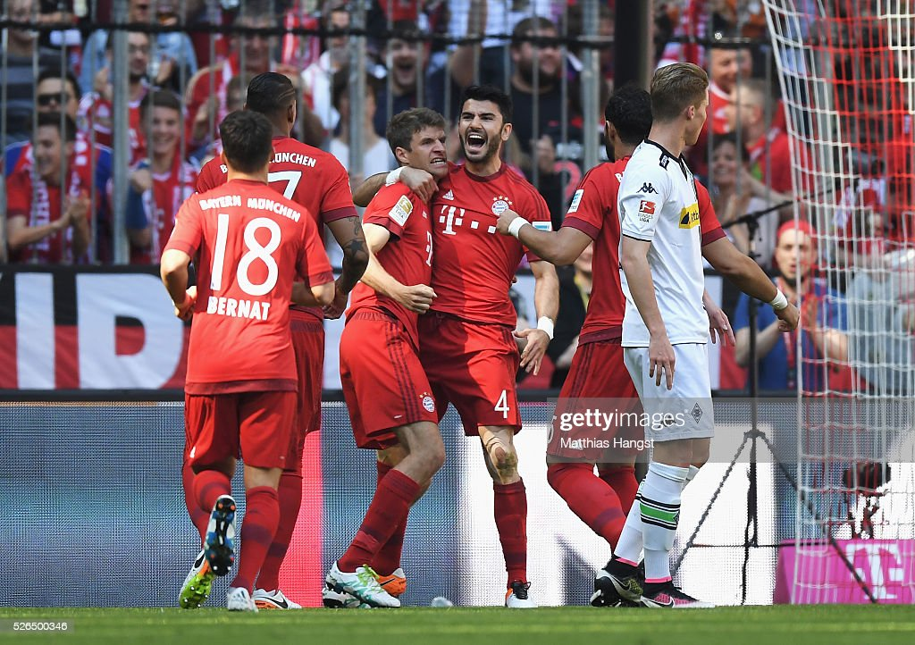 Serdar Tasci (4th L) of Bayern Muenchen celebrates scoring his team's first goal with his team mates during the Bundesliga match between Bayern Muenchen and Borussia Moenchengladbach at Allianz Arena on April 30, 2016 in Munich, Germany.