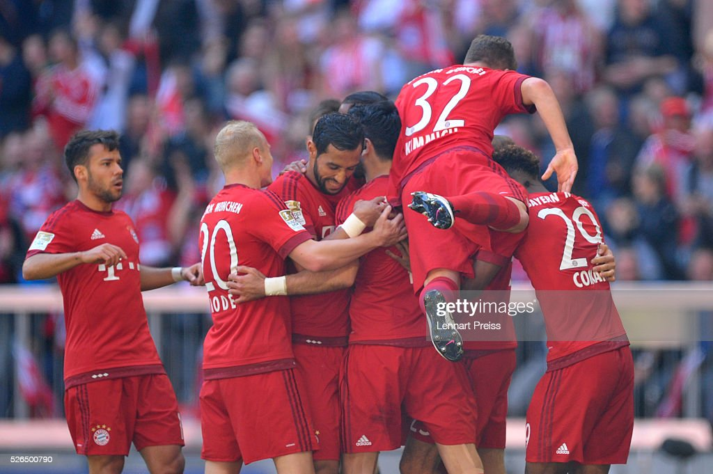 Serdar Tasci (C) of Bayern Muenchen celebrates scoring his team's first goal with his team mates during the Bundesliga match between Bayern Muenchen and Borussia Moenchengladbach at Allianz Arena on April 30, 2016 in Munich, Germany.