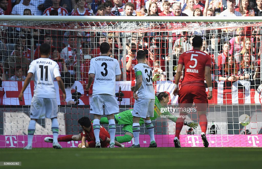 Serdar Tasci (2nd L) of Bayern Muenchen scores his team's first goal during the Bundesliga match between Bayern Muenchen and Borussia Moenchengladbach at Allianz Arena on April 30, 2016 in Munich, Germany.