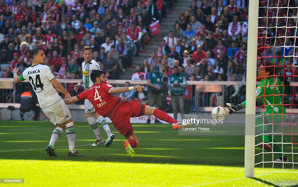 Serdar Tasci of Bayern Muenchen scores his team's first goal during the Bundesliga match between Bayern Muenchen and Borussia Moenchengladbach at Allianz Arena on April 30, 2016 in Munich, Germany.
