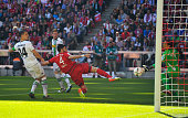 Serdar Tasci of Bayern Muenchen scores his team's first goal during the Bundesliga match between Bayern Muenchen and Borussia Moenchengladbach at...