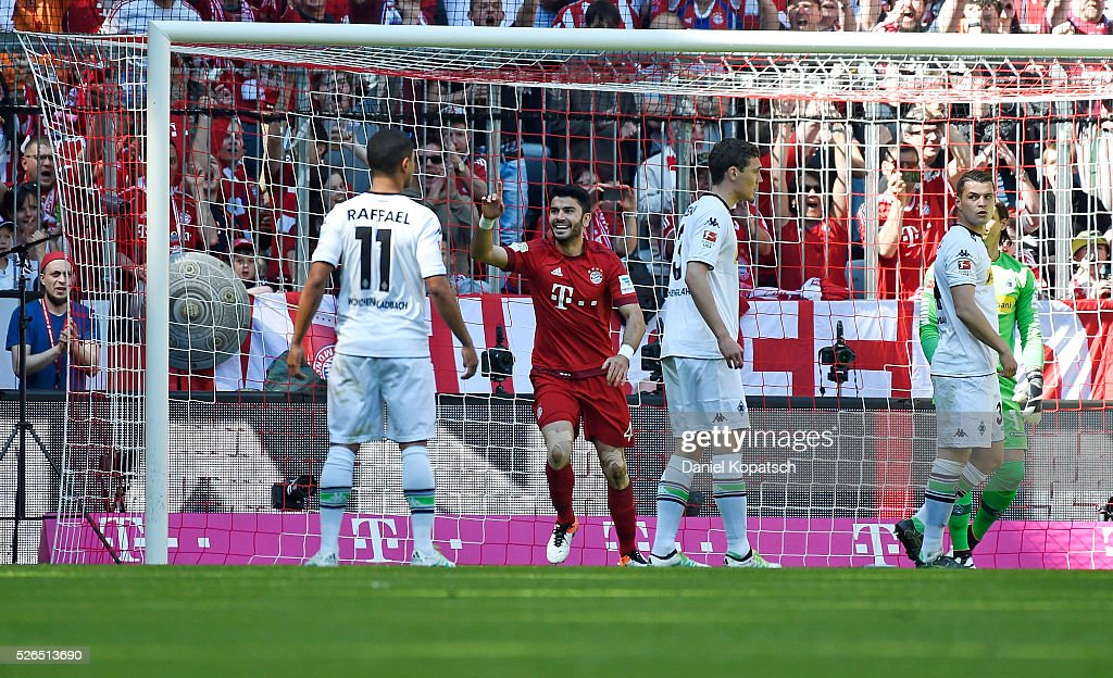 Serdar Tasci of Muenchen celebrates his team's first goal during the Bundesliga match between FC Bayern Muenchen and Borussia Moenchengladbach at Allianz Arena on April 30, 2016 in Munich, Germany.