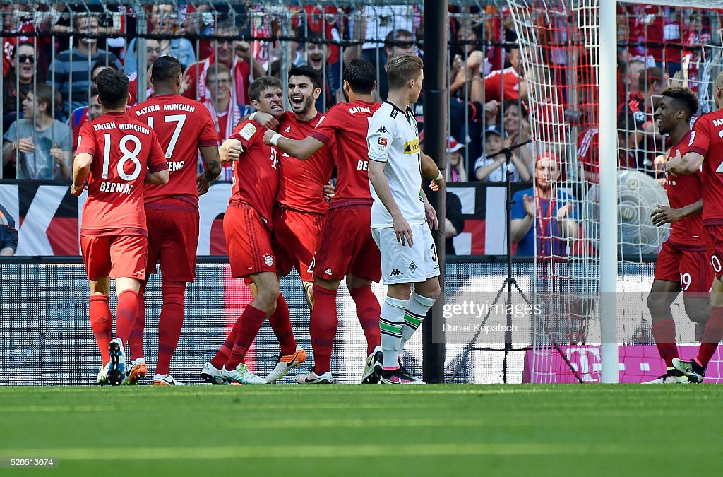 Serdar Tasci of Muenchen celebrates his team's first goal with team mates during the Bundesliga match between FC Bayern Muenchen and Borussia Moenchengladbach at Allianz Arena on April 30, 2016 in Munich, Germany.