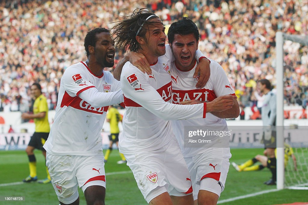 <a gi-track='captionPersonalityLinkClicked' href=/galleries/search?phrase=Serdar+Tasci&family=editorial&specificpeople=787688 ng-click='$event.stopPropagation()'>Serdar Tasci</a> of Stuttgart celebrates his team's first goal with team mates <a gi-track='captionPersonalityLinkClicked' href=/galleries/search?phrase=Martin+Harnik&family=editorial&specificpeople=733193 ng-click='$event.stopPropagation()'>Martin Harnik</a> and <a gi-track='captionPersonalityLinkClicked' href=/galleries/search?phrase=Cacau&family=editorial&specificpeople=178248 ng-click='$event.stopPropagation()'>Cacau</a> (R-L) during the Bundesliga match between VfB Stuttgart and Borussia Dortmund at Mercedes-Benz Arena on October 29, 2011 in Stuttgart, Germany.