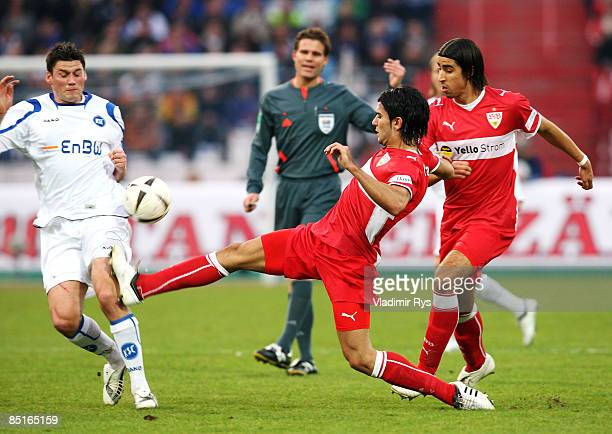 Serdar Tasci of Stuttgart fouls Giovanni Federico of Karlsruhe during the Bundesliga match between Karlsruher SC and VfB Stuttgart at the Wildpark...