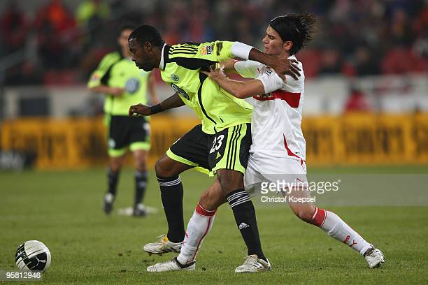 Serdar Tasci of Stuttgart tackles Grafite of Wolfsburg during the Bundesliga match between VfB Stuttgart and VfL Wolfsburg at the MercedesBenz Arena...