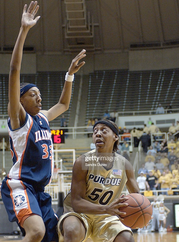 Sereka Wright looks to find room to shoot around Angelina Williams in the second half of Purdue's 6549 win
