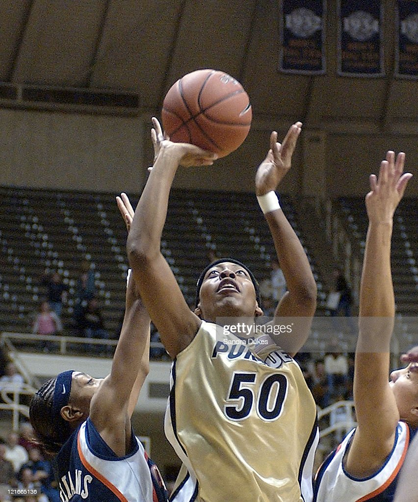 Sereka Wright shoots for 2 of her 18 points over Angelina Williams and Cindy Dallas in the second half of Purdue's 6549 win