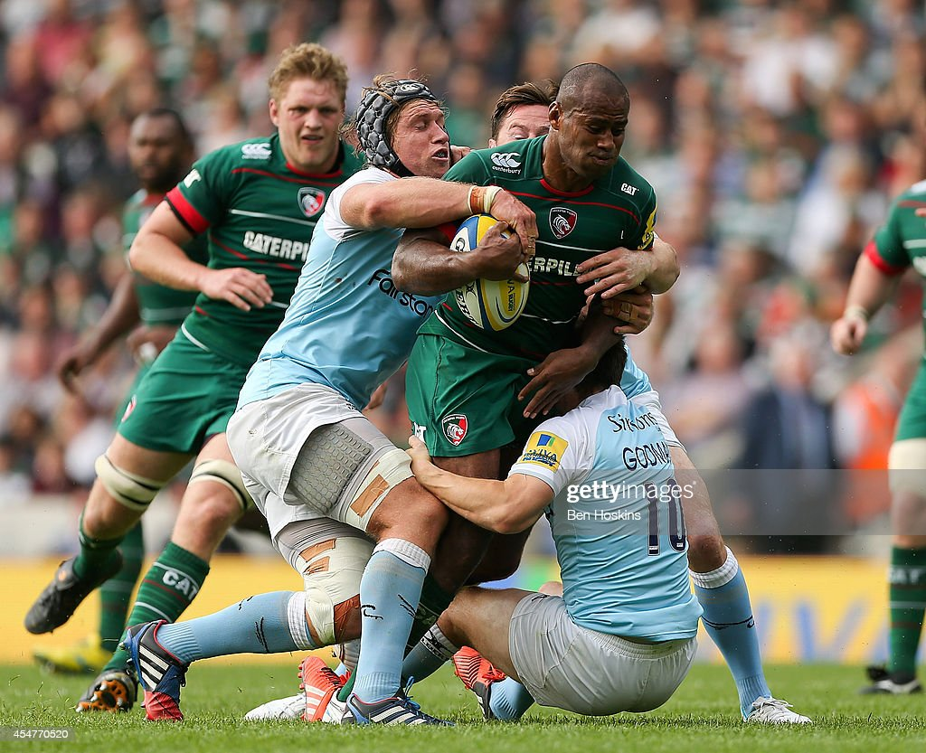 Seremaia Bai of Leicester is tackled by Richard Mayhew (L) and <a gi-track='captionPersonalityLinkClicked' href=/galleries/search?phrase=Phil+Godman&family=editorial&specificpeople=556869 ng-click='$event.stopPropagation()'>Phil Godman</a> (R) of Newcastle during the Aviva Premiership match between Leicester Tigers and Newcastle Falcons at Welford Road on September 6, 2014 in Leicester, England.