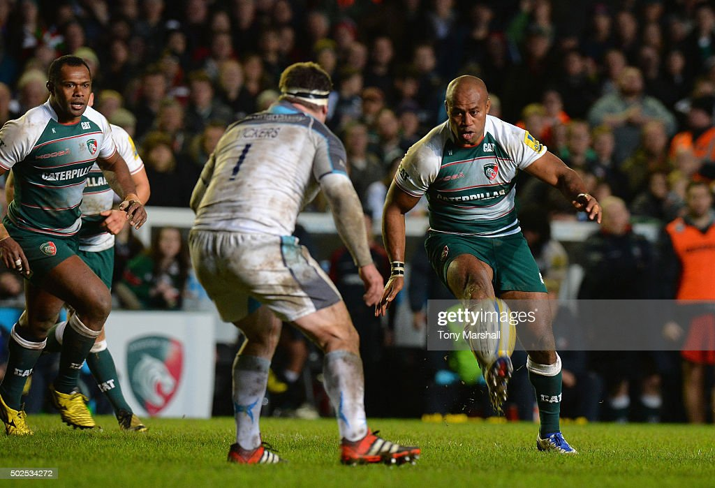 Seremaia Bai of Leicester Tigers chips the ball over Rob Vickers of Newcastle Falcons during the Aviva Premiership match between Leicester Tigers and Newcastle Falcons at Welford Road on December 26, 2015 in Leicester, England.