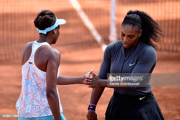 Serena and Venus Williams of the United States react during their Women's Doubles match against Andreja Klepac and Katarina Srebotnik of Slovenia on...