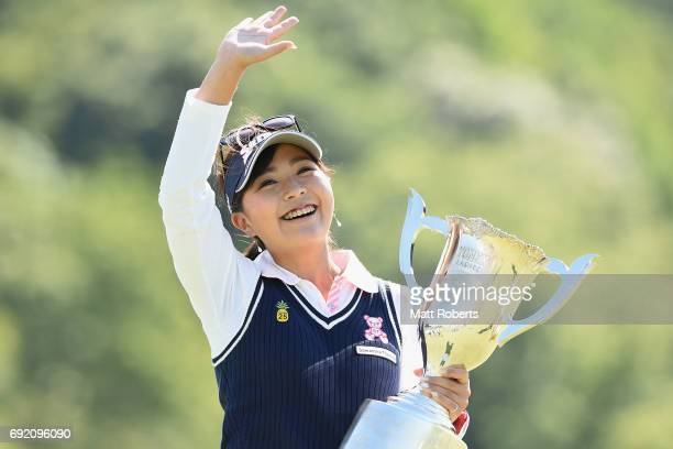 Serena Aoki of Japan acknowledges the crowd as she holds the winners trophy during the final round of the Yonex Ladies Golf Tournament 2016 at the...