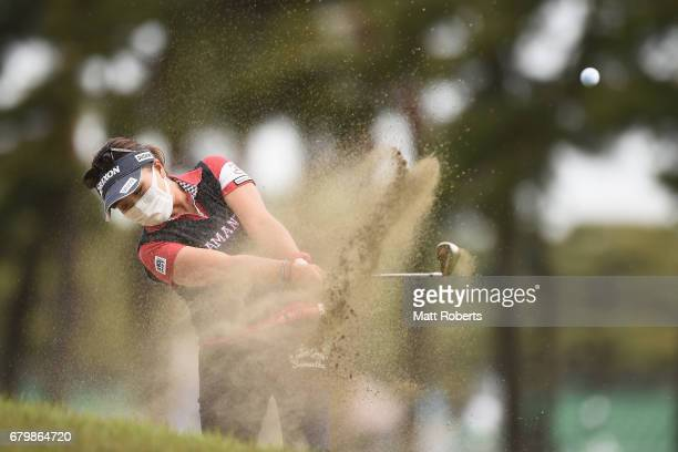 Serena Aoki of Japan hits out of the fairway bunker on the 1st hole during the final round of the World Ladies Championship Salonpas Cup at the...