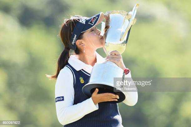 Serena Aoki of Japan kisses the winners trophy during the final round of the Yonex Ladies Golf Tournament 2016 at the Yonex Country Club on June 4...