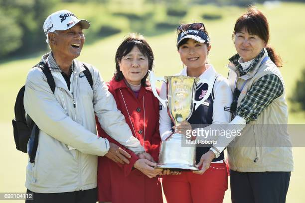 Serena Aoki of Japan poses with her family and the winners trophy during the final round of the Yonex Ladies Golf Tournament 2016 at the Yonex...