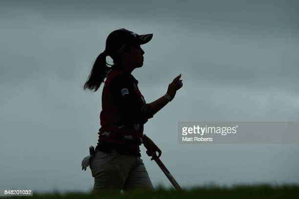 Serena Aoki of Japan reacts after her putt on the 14th green during the final round of the Munsingwear Ladies Tokai Classic 2017 at the Shin Minami...