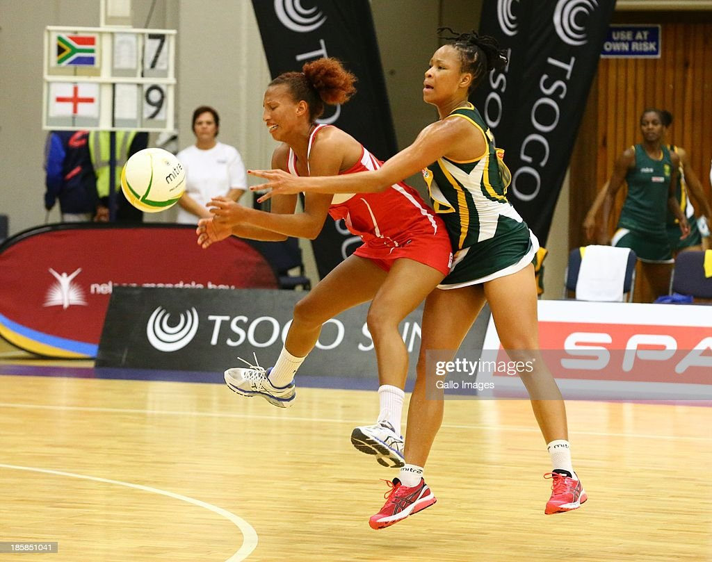 Serena Guthrie of England and Zanele Mdodana of South Africa during the International SPAR Tri Nations netball final match between South Africa and England at Vodacom NMMU Indoor Stadium on October 25, 2013 in Port Elizabeth, South Africa.