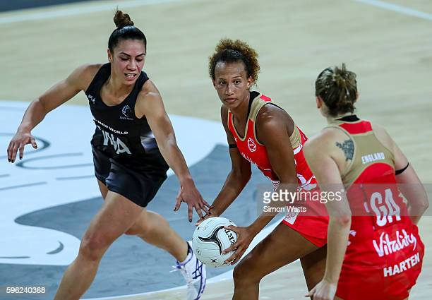 Serena Guthrie of England looks to pass under pressure from Grace Rasmussen of New Zealand during the International Test Match between New Zealand...